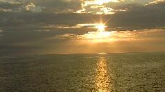 Sunset Over a Golden Ocean Stock Footage