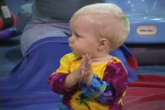 Bouncy shot of baby clapping Stock Footage