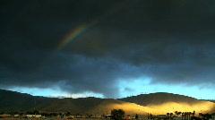 Desert wind farm with rainbow Stock Footage