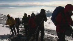 Hikers close to summit Stock Footage