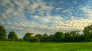 Blue sky over fields hdr time lapse Stock Footage