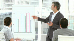 Male executive reporting sales figures to his team Stock Footage