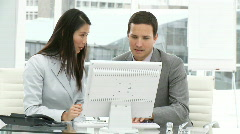 Assertive business team working at a computer - stock footage