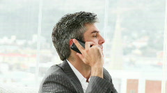 Serious businessman on phone Stock Footage