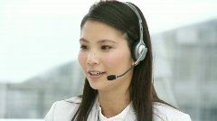 Pretty businesswoman with headset on Stock Footage