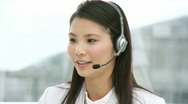 Stock Video Footage of Pretty businesswoman with headset on