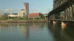 Bicyclist Crosses the Steel Bridge in Downtown Portland, Oregon Stock Footage