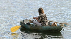 Salty Old Man Rowing His Boat Stock Footage