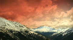 (1151) Early Early Colorado Winter Mountains Snow Sunset Clouds Skiing LOOP! - stock footage