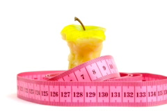 Tape measure wrapped around rotating apple core, loopable ntsc Stock Footage