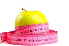 Tape measure wrapped around rotating bitten apple, loopable ntsc Stock Footage