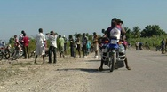 People in Haiti on street after earthquake m Stock Footage