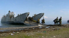 Marines exit Landing Craft on Beach (HD) m Stock Footage