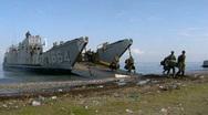 Marines exit Landing Craft on Beach (HD) m Stock Footage