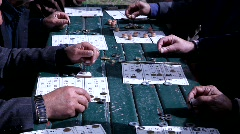 Senior citizens play BINGO in the park Stock Footage