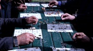 Stock Video Footage of Senior citizens play BINGO in the park