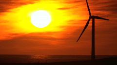 Sunset Silhouette of Wind Turbine Stock Footage