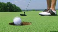 Golfer Sinks Putt 02 Stock Footage