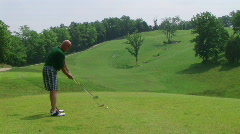 Golfer Teeing Off With Driver 02 Stock Footage