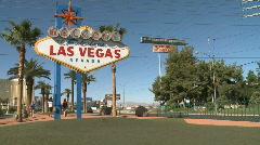Tourists mill around Las Vegas sign - stock footage