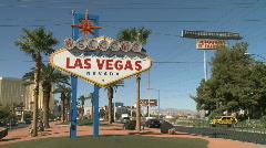 Visitors cross street to see Las Vegas sign Stock Footage