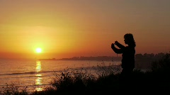 Tai Chi Dusk on the Ocean Cliffs Stock Footage