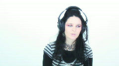Goth girl and headphones - 1 - doing the crawl Stock Footage