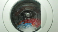 Washing machine and colorful laundry Stock Footage