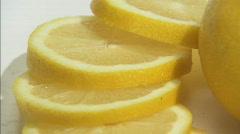 Lemon cut spin close2 Stock Footage