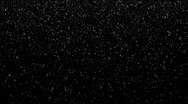 Very small snow flakes falling on black background, loopable Stock Footage