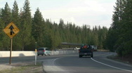 Trucks entering freeway Stock Footage