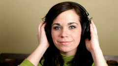 Girl looking at camera with Headphones on Stock Footage