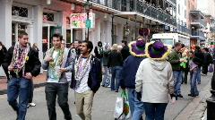Group of People walking down Bourbon Street - stock footage