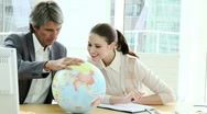 Stock Video Footage of Charismatic business partners looking at a terrestrial globe