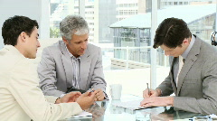 Ambitious businessmen having a collaboration - stock footage