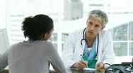 Male doctor prescribing medicines to his patient Stock Footage