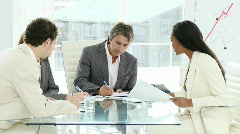 A meeting of a multi-cultural business team - stock footage