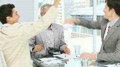 Enthusiastic businessmen celebrating collaboration Stock Footage