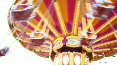 Shone carousel fast turns in park close up in summer Stock Footage