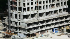 review from below upwards an under construction high-rise building - stock footage