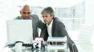 Two disappointed businessmen working at a computer Stock Footage