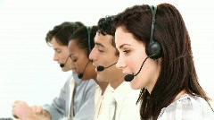 Smiling businesspeople working in a call center Stock Footage