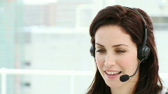 Assertive businesswoman working in a call center - stock footage