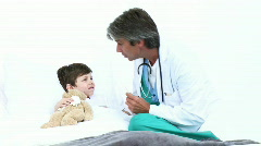 Adorable little boy attending a medical check-up Stock Footage