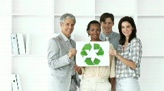 Self-assured business team showing the concept of recycling - stock footage