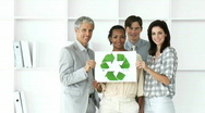 Stock Video Footage of Self-assured business team showing the concept of recycling