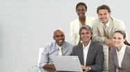 Enthusiastic business team working at a laptop Stock Footage