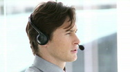 Caucasian businessman working in a call center Stock Footage