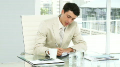 Concentrated businessman writing in his agenda - stock footage