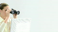 Charismatic businesswoman looking through binoculars Stock Footage